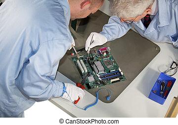 motherboard repairs - IT - engineers doing repairs on a...