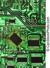 Motherboard. - Green circuit board detail.