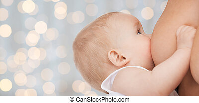 close up of mother breast feeding adorable baby
