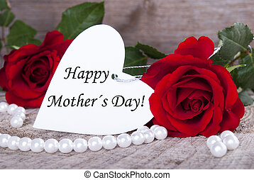 Background with Roses and white Label with Happy Mothers Day on it