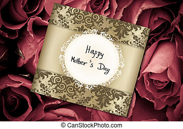 Mother's Day card on a background of red roses
