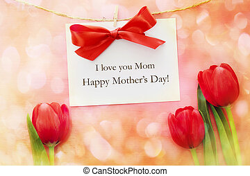 Mothers day card over red tulips