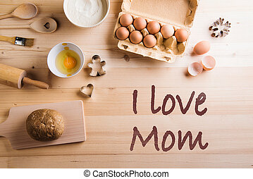 Mothers day composition. Baking ingredients and kitchen utensils