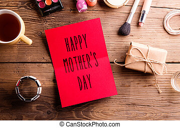 Mothers day composition. Greeting card and make up products.