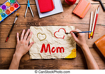 Mothers day composition. School supplies. Wooden background. Stu