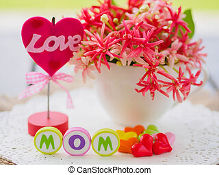 mother's day concept. LOVE MOM alphabet