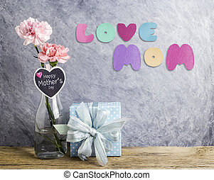 Mothers day concept of pink carnation flowers in clear...
