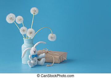 Mothers day congratulation with gift box and dandelions