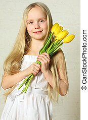 Mother's Day - cute child with flowers tulips