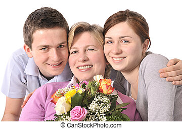 mothers day - mother receives a bunch of flower from her ...