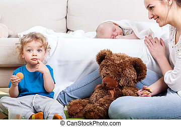 Mother's free time with children in living room