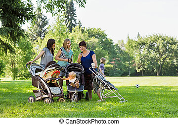 Mothers With Baby Strollers Reading Text Message - Happy...