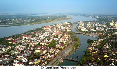 motion above channel of old Hoian against wide river -...