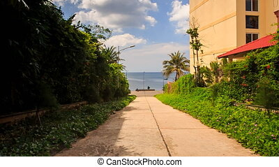 Motion along Pavement by Green Hedge Hotel to Sea Beach -...