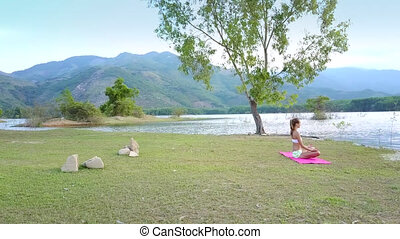motion around girl on lake bank against highland