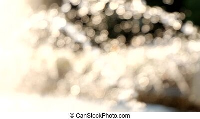 Motion background of defocused water drops of city fountain backlit