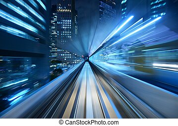 Motion Blur - Motion blur of a city and tunnel from inside a...