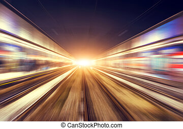 Motion blur movement through the city at night by train