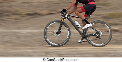 Motion blur of a mountain bike race with the bicycle and rider