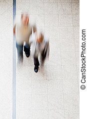 Motion blur of people walking together