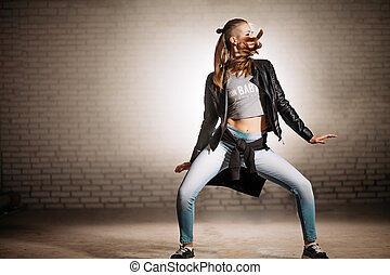 motion blur photo of dancing girl on rock music. being mad of music. be fond of rock