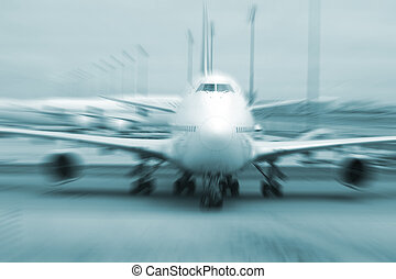 motion blurred airplane on runway