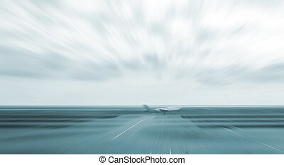motion blurred airplane on runway, background