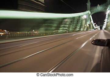 Motion blurred bridge by night