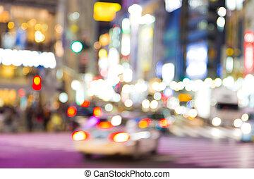 Motion blurred car transport night life at Shibuya Tokyo