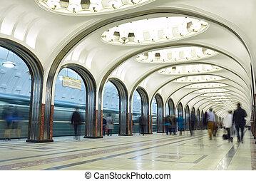 Motion blurred commuters at the metro station. Mayakovskaya...