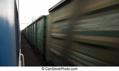 motion blurred freight train, view from train moving in an...