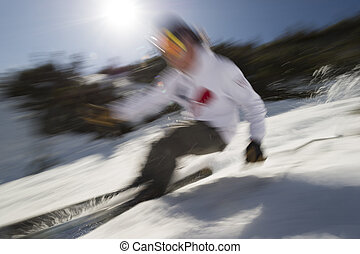 Motion blurred image of an expert skier. - Motion blurred...