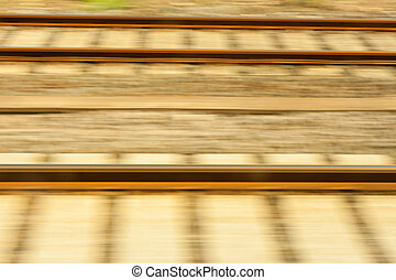 Motion Blurred Railway Tracks - Rapid motion blurs adjacent...