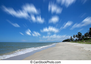 Motion cloud in blue sky on the beach.