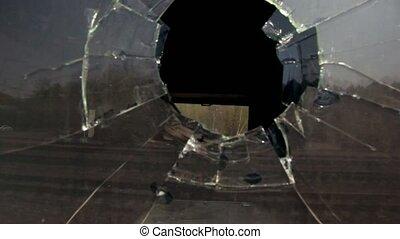 Motion inside hole in broken window at railcar, dark...