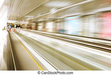 Motion of escalator in glass corrid