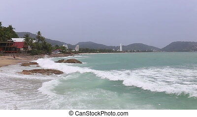 Motion of high speed waves tropical turquoise beach with stone at Kata beach Phuket sea  Thailand