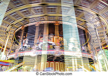 Motion of vintage merry-go-round carousel.