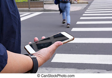 Motion of woman crossing street and holding phone in Taipei Taiwan