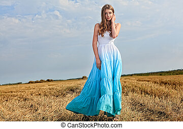 motion - Romantic young woman posing outdoor.