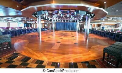 Motion through empty dance floor in night club at day on ship