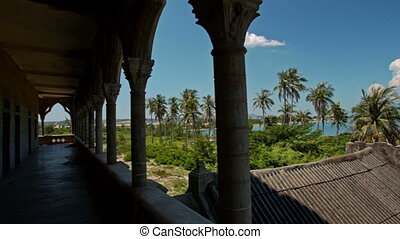 Motion Through Shady Gallery against Palms Sea Blue Sky -...
