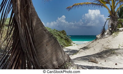 motion timelapse of a perfect paradise beach with a lone...