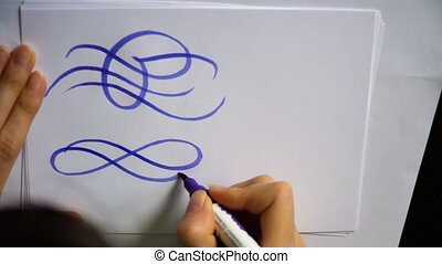 motion video female hand writes a calligraphic flourish on...