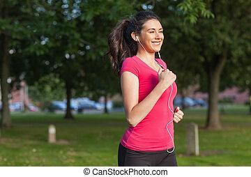 motivado, deportivo, mujer que corre, en, un, parque