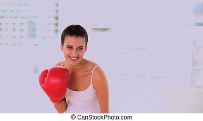 Motivated beautiful woman exercising