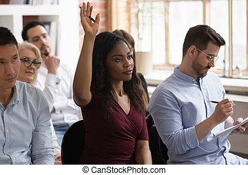 Motivated black female raise hand take part in training