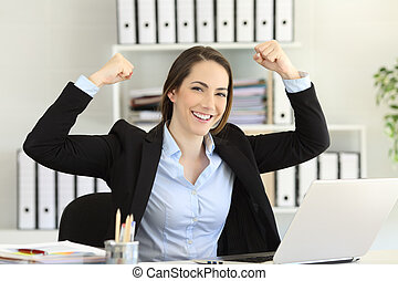 Motivated businesswoman looking at camera at office