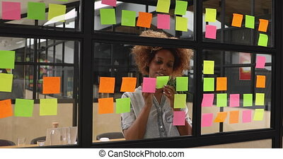Motivated millennial mixed race employee working on project ...