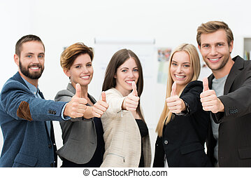 Motivated successful business team of diverse young...